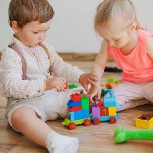 children-with-toys-floor_23-2147663873